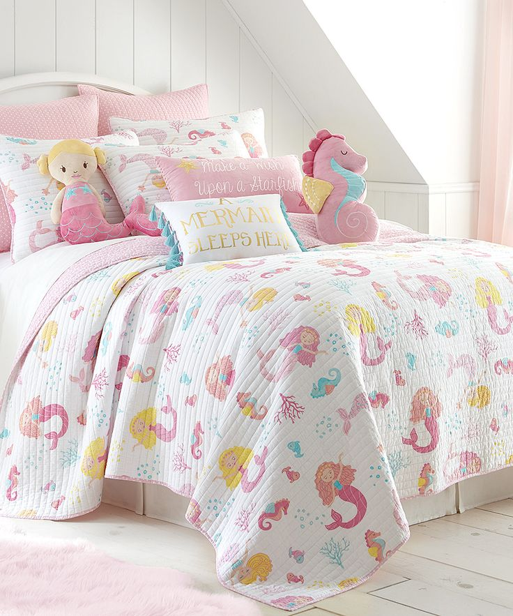 Decorate her room in sweet sea-inspired style with this whimsical quilt set boasting an adorable mermaid motif.Includes quilt and two shams (twin sizes include one sham)100% cottonMachine wash; tumble dryImported