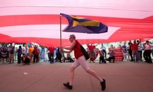 A supporter of gay marriage runs beneath a so-called equality flag outside the supreme court, where the justices handed down their decision on the matter in Washington DC.