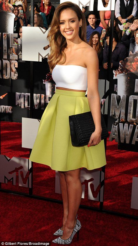 Fantastic form: Jessica was displaying her stunning figure in a lemon yellow high-waisted skirt with a white strapless crop top