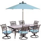 Hanover Traditions 7-Piece Outdoor Dining Set with Rectangular Glass Table, Swivels, Umbrella and Base with Blue Cushions