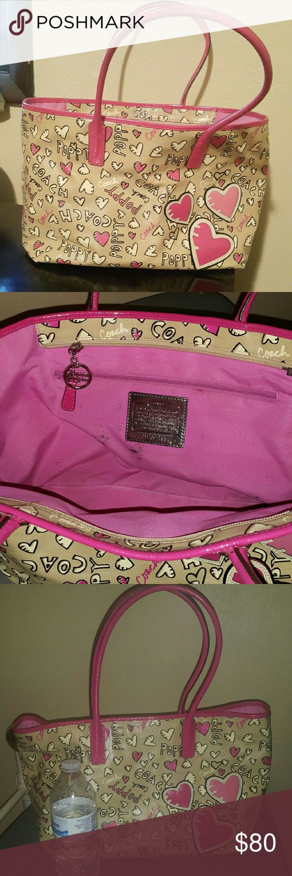 Coach poppy bag pink leather Authentic coach pink poppy handbag. Outside is in excellent flawless condition almost brand new, the inside liner has pen marks, I have not attempted to remove them so may come out with stain remover. Photo with water bottle gives an idea of size. Strap is wide enough  to carry as a shoulder bag or satchel purse. Coach Bags Shoulder Bags