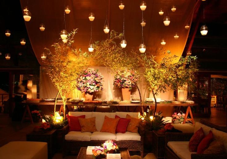 Cozy, casual and elegant. love the lights and plants. The long table and floral arrangements are beautiful