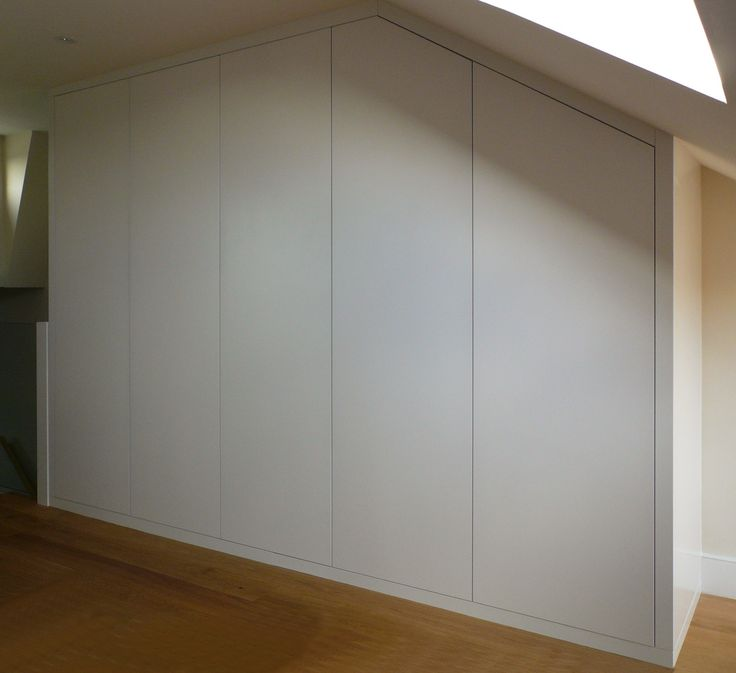Proline interiors - fitted minimalist wardrobe, finished in a white satin spray lacquer with touch latch opening doors.