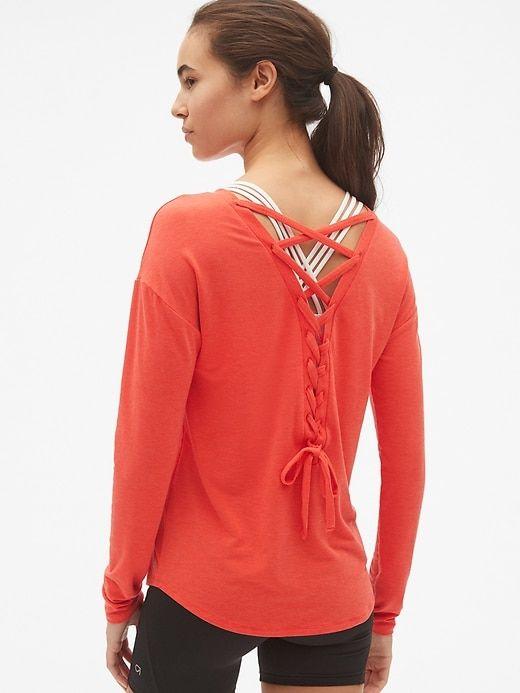 4633a83aa96 Gap Women s Gapfit Breathe Long Sleeve Lace-Up Back T-Shirt Hot Red ...