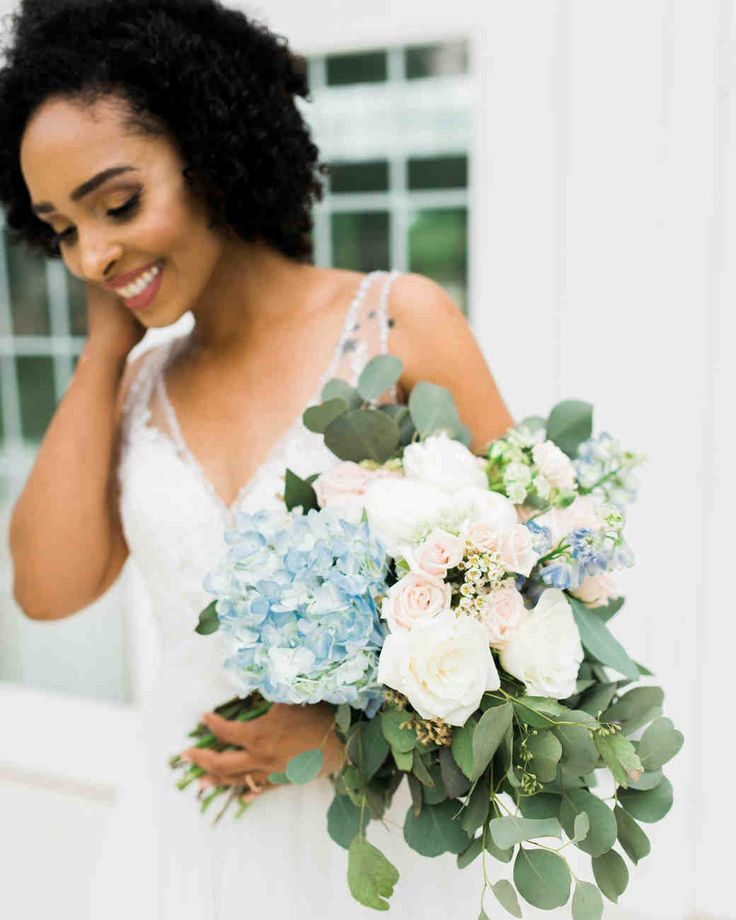 "20 Blue Color Wedding Palettes We Love | Martha Stewart Weddings - Work your ""something blue"" into your wedding bouquet by carrying a bunch (like this romantic floral arrangement) with blue hydrangea, white and blush roses, and eucalyptus down the aisle. #weddingflowers #weddingbouquets #weddingdresses #wedding"