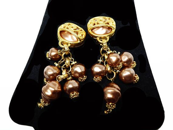 New Listings Daily - Follow Us for UpDates -  Description & Style:   Dangling Brown Faux Pearls Earrings - Clip ons by Robert Rose - #Vintage Retro Pre 1998 - Pearlescent Brown Beads - Satin Gold Tone Chains offered by ... #vintage #jewelry #teamlove #etsyretwt #ecochic