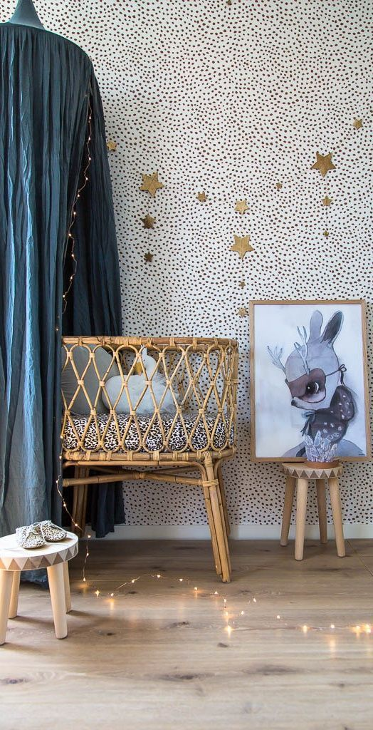 Patterned dotted black and white wallpaper, vintage wicker bassinet, teal canopy, artwork - gorgeous!!