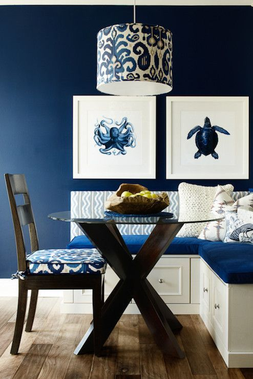 charming blue and white dining room kitchen area with nautical seaside décor accents.