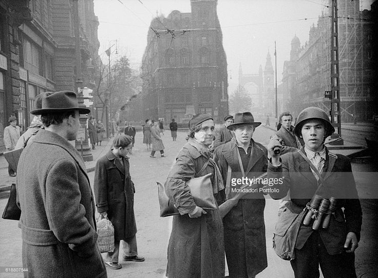 Hungarian revolution of 1956. Two young revolutionaries in the streets of the city during the uprising agianst the Soviet regime: Julia Sponga (with a helmet and a bandage on her face) and her boyfriend Gyorgy. Budapest, 29th October 1956