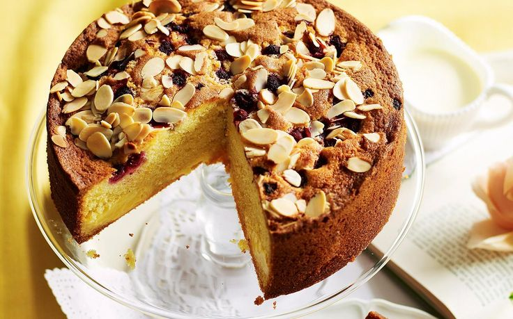 This moist and buttery tea cake, adorned with raspberries and almond flakes is a wonderful afternoon or after-dinner treat - especially with thickened cream. Recipe by the Australian Women's Weekly.