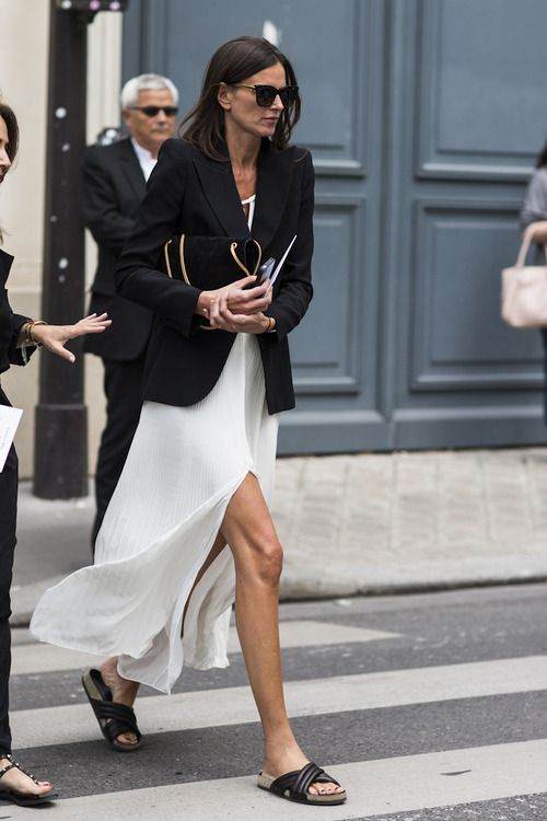 {Street style} | Black blazer, white slit maxi dress, black slip on sandals, black clutch.