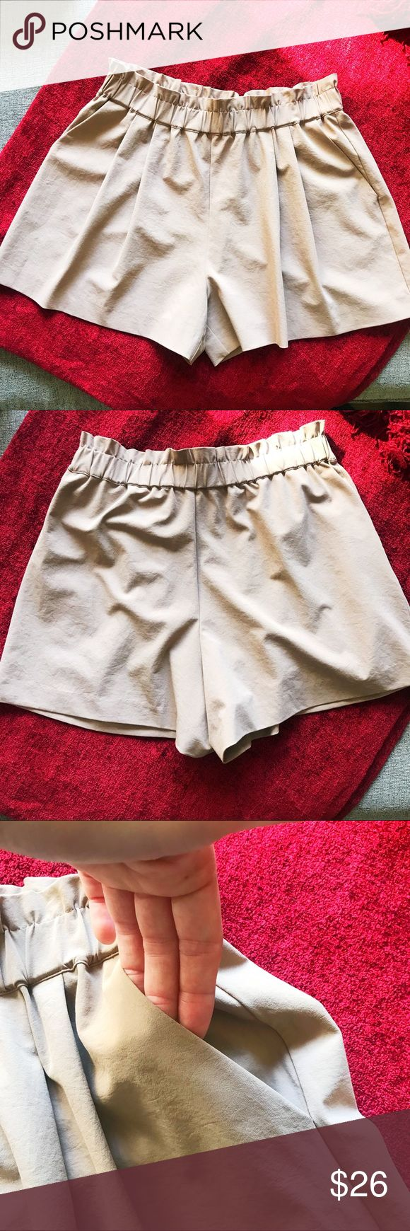 """Armani Exchange Flare Beige Shorts Beige flare shorts by Armani Exchange. Since Medium. Waist features elastic band 14"""" flat can extent up to 18"""". Please see pictures for other measurements. It has two functional pockets in front. Gently used item in excellent condition. A/X Armani Exchange Shorts"""