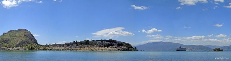 Port of #Nafplio with a luxury Mediterranean cruise ship anchored off the entrance to the town's small port. - #Greece