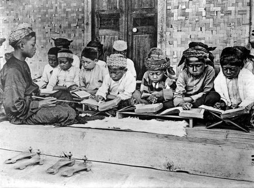 Children studying Koran in Java during colonial period.