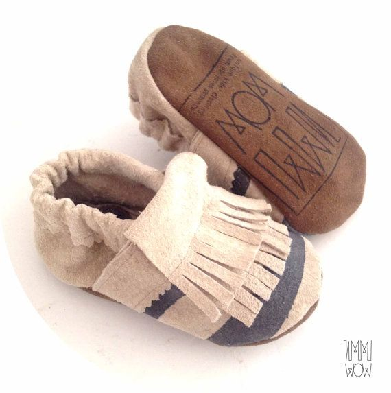 I am creating lovely little things and shoes for kids out of unwanted clothes.  Here we have a pair of cute moccasins for little kids. The moccs are