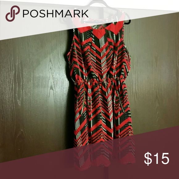 Red, black and white Casual dress Rainbow store (dress).. Pockets on the sides with gold zipper. Dress up with some heels go out for the night.  Worn one time in great condition no marks or stains on the dress. Ready to wear with heels or sandals. Rainbow  Dresses