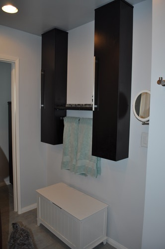 New bathroom remodel with contemporary cabinets and towel hanger.