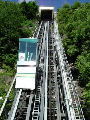 Close-up photo of funicular in Old Québec. Built by William Griffith, the first funicular went into operation on November 17, 1879. The cabins scaled up & down the escarpment by means of a counter weight water process & steam power. In 1907, Alexander Cummings converted the funicular to electrical power.