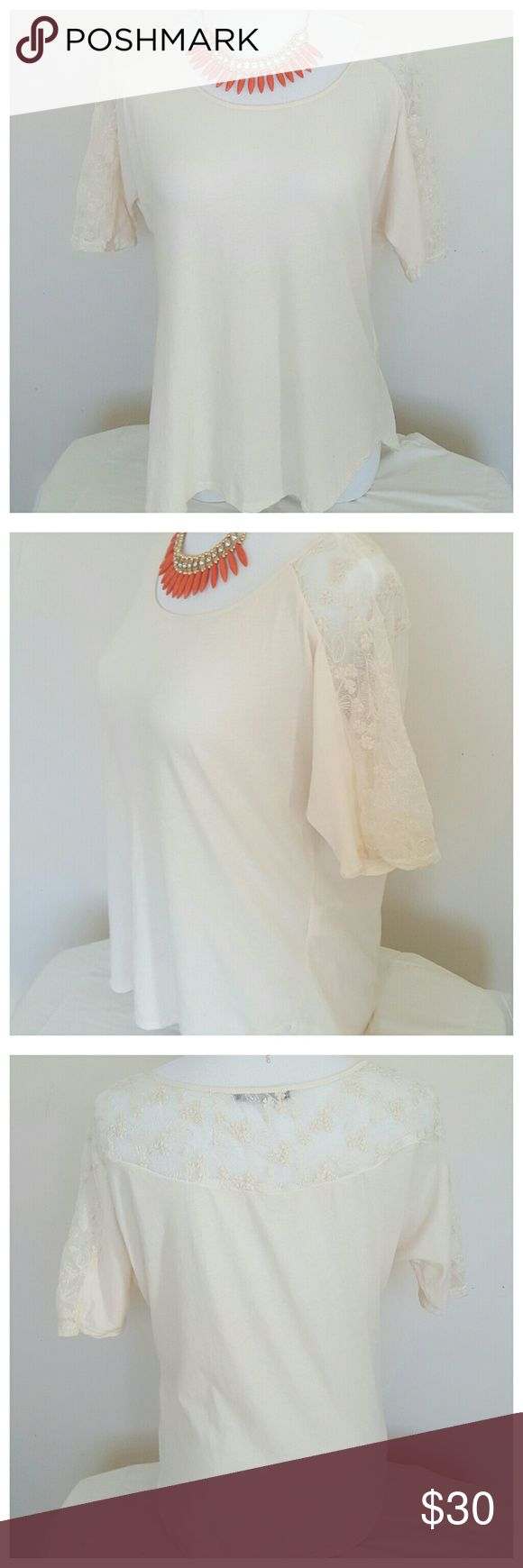 """Velvet Cream Short Sleeve Top with Lace Cream colored, semi short sleeved top with lace from shoulder down the sleeves. Size small. 21-24"""" length ranges. 65% Polyester/35% Cotton. 100% Cotton contrast. Pre-loved,very good condition. No flaws. Velvet Tops"""