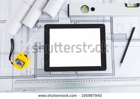 Closeup of digital tablet with architect's tools on blueprint - stock photo
