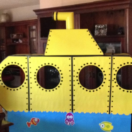 "inside classroom back of door decoration?  Running into the ""word wall"".  Top of submarine above door."