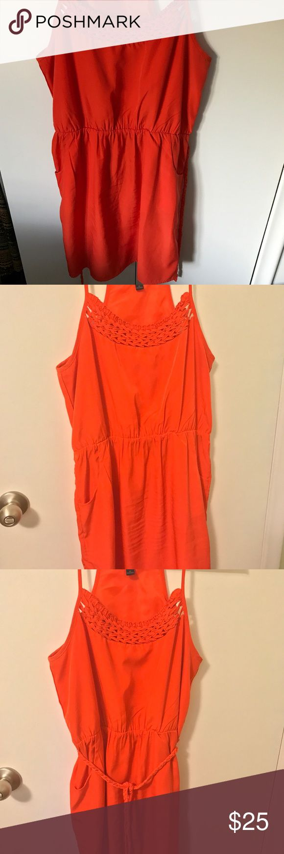 """Banana Republic Petite Cocktail Dress w/ Pockets! Banana Republic Petite Cocktail Dress • Bright Orange • Slightly worn • Has a pocket on either side! • Lattice neckline • Braided belt • Has a shorter lining • Perfect dress for a night out on the town or even a cocktail wedding • Pair with black heels and statement earrings for a classy look! •  100% Polyester shell 100% Polyester Lining • Measured Flat 18.5"""" pit to pit, 34.5"""" shoulder to hem • All measurements approximate. Banana Republic…"""