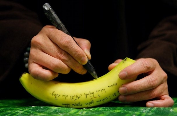 Brother Phap Huy writes a get well note on a banana for a sister who was ill and could not attend lunch at Magnolia Grove Monastery. A care package was sent to her to make her feel better. All the meals that are prepared by the monks and nuns and are vegan. (Alan Spearman/The Commercial Appeal)    I am here for you.  - Tich Nhat Hanah
