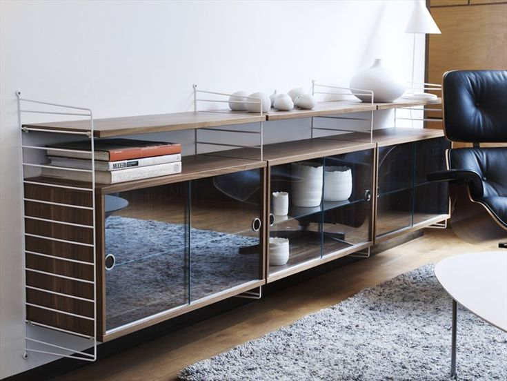WALL-MOUNTED SECTIONAL SHELVING UNIT SYSTEM BY STRING FURNITURE | DESIGN NILS STRINNING