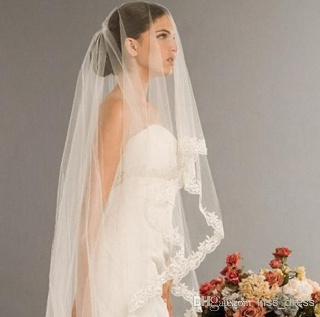 Over the face veil with low chignon