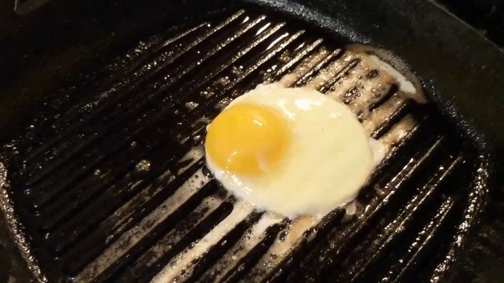 Cooking eggs in my modern Lodge cast iron grill pan.