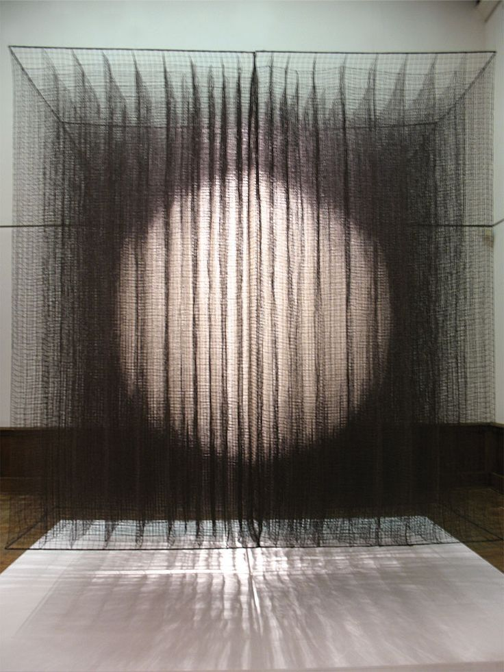 Rebecca Medel, The One, knotted cotton, 750 parts stitched together at perpendicular intersections, 8 x 8 x 8 ft.