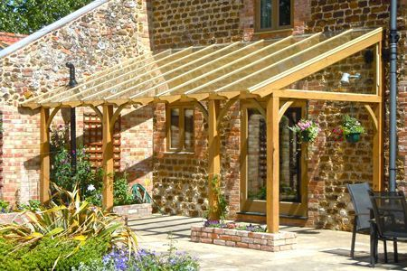 sloping lean to style pergola for outdoor sitting area