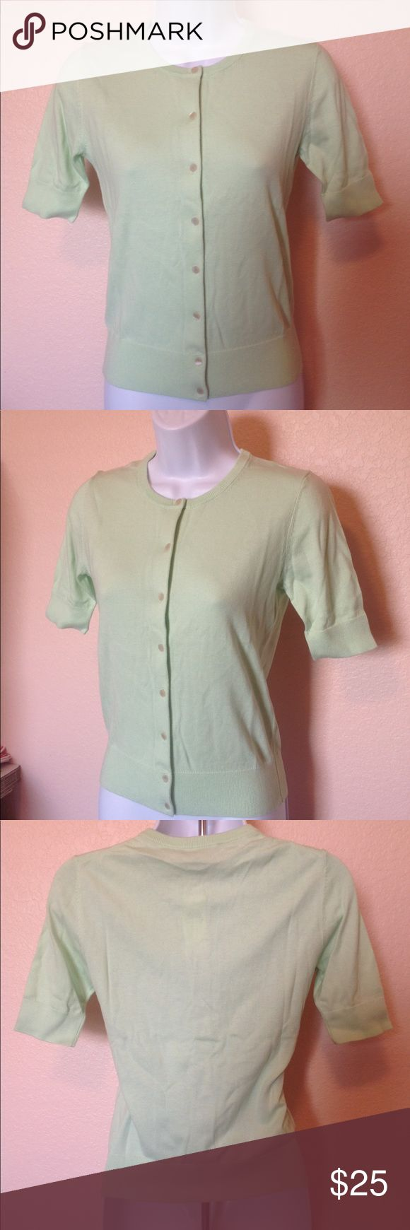 "NWT Ann Taylor Green Short Sleeve Cardigan Size XS Details:  Up for your consideration is a beautiful NWT pastel green short sleeve cardigan size XS by Ann Taylor.  Flat Measurements:  Bust (armpit to armpit) – 16""  Length – 22""  *Item is made from a stretchy material* Ann Taylor Sweaters Cardigans"