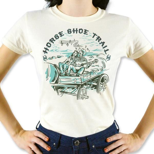 Horse Shoe Trail Tee Inspired by all the historic American trails that cowboys and cowgirls used to explore the Wild West. Grab your guitar and cowboy beans and