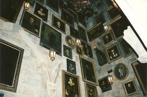 I gaze up at the portraits above me, searching for a specific one. Some of the people tried to talk to me, while others turned their heads and talked to their neighbors. Finally I spotted it: my great grandpa, who had once been head boy at this school and achieved great status in the wizarding world. I tried calling his name, but it was no use. I had to talk to him, but he was too high... I hear footsteps behind me and whirl around. (Open rp with Charlotte)