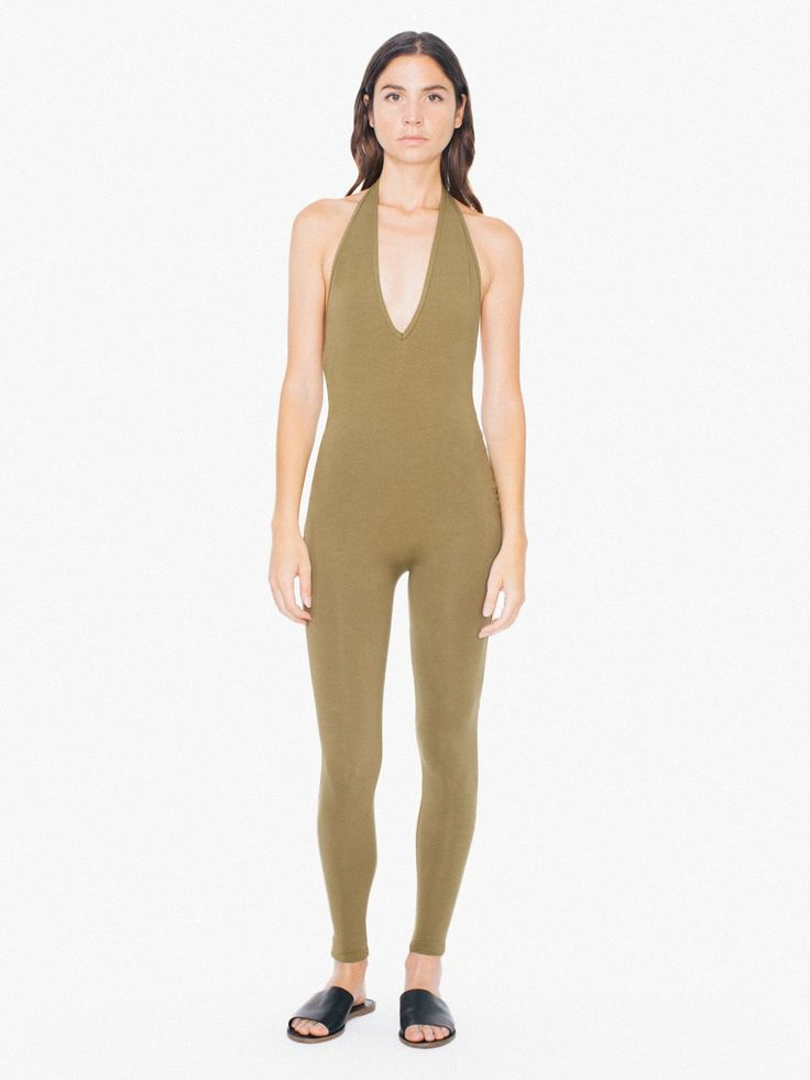 Form-fitting cotton spandex catsuit with halter top, low V-neck and open back.