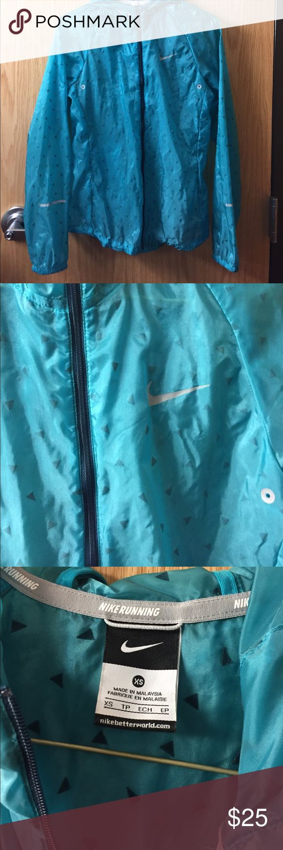 Nike Raincoat Perfect light raincoat! Color shown best in 2nd photo, more of a turquoise color. EUC. Nike Jackets & Coats
