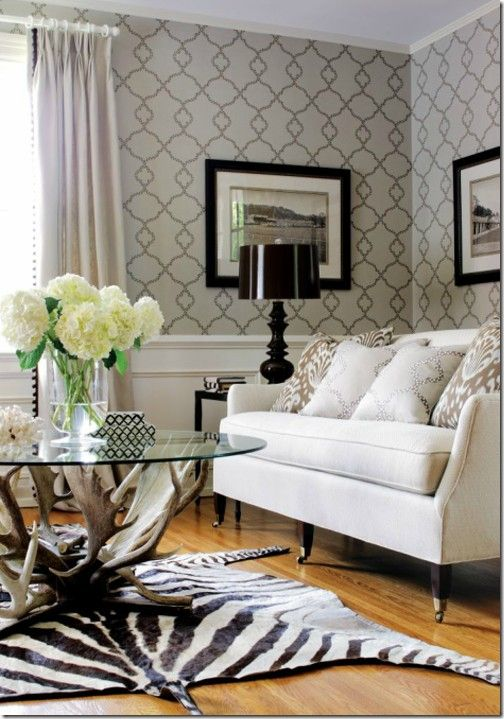 animal print rug is a neutral in a room wood base coffee table along with the rug are wonderful textures here and pop the room