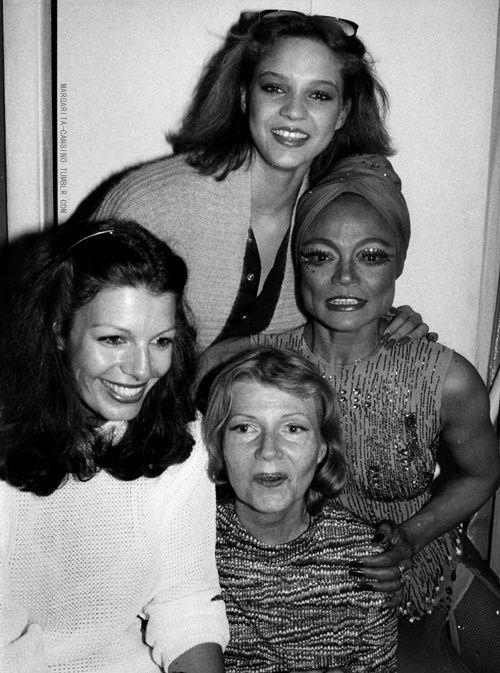 Rita Hayworth and Eartha Kitt pose backstage with their daughters, Yasmin Kahn and Kitt McDonald