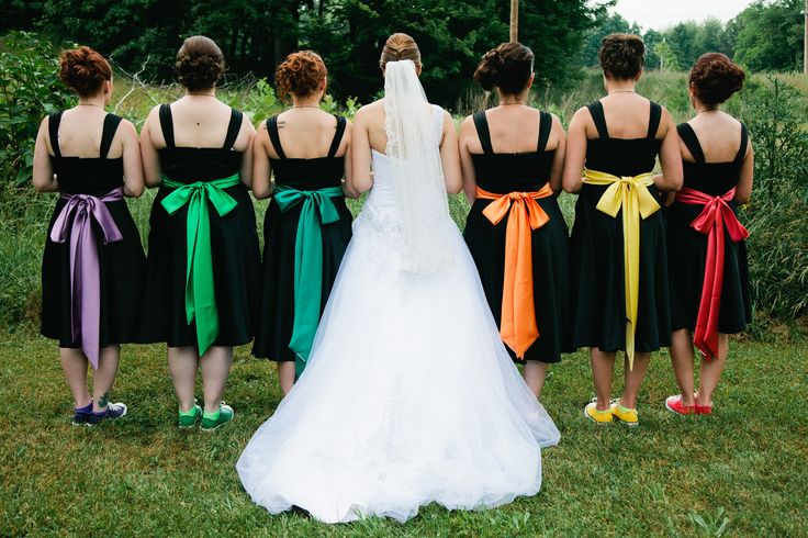 Ideas how to use all the colours of the rainbow for your wedding colour scheme. Bridesmaids dresses black with coloured sashes and shoes.