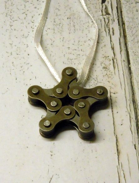 Upcycled bicycle chain star christmas tree decorations made by cambridge's re-creations project