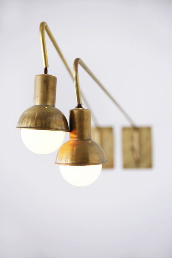 INDUSTRIAL INTERIORS: GOLDEN WALL SCONCES_see more inspiring  articles at http://vintageindustrialstyle.com/industrial-interior-golden-wall-sconces/