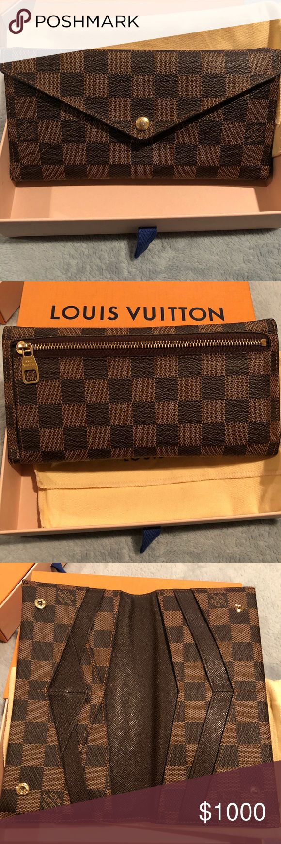 """♦️Louis Vuitton Damier Ebene Origami Wallet♦️ ♦️Authentic Louis Vuitton Damier Ebene Origami Wallet♦️  Beautiful Pre-Loved no longer made Origami Wallet  Comes with, wallet, dust bag, box  ❌Final Sale❌   Rude Comments will be BLOCKED♀️  Includes fourteen card holders, five pockets, and one exterior zip pocket. Original Louis Vuitton Box and dust bag is included.  Dimensions: 7.75""""W x 1""""D x 4""""H Louis Vuitton Bags Wallets"""