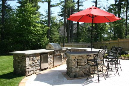 I love this built in outdoor barbeque design because it has the umbrella and the sitting/eating area. Just right.