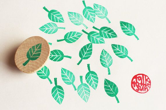 *small leaf hand carved rubber stamp/wedding guest book stamp. mounted on wooden disc. there are some sets of leaf rubber stamps available. all