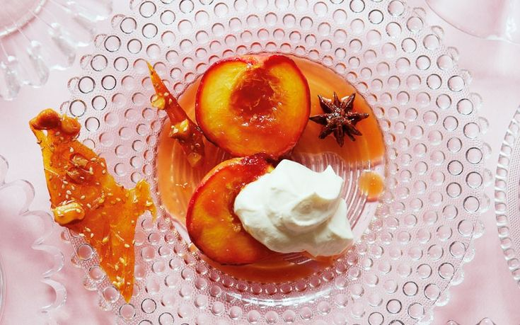 Tender baked nectarines with ginger and star anise served with crisp, nutty caramel pieces