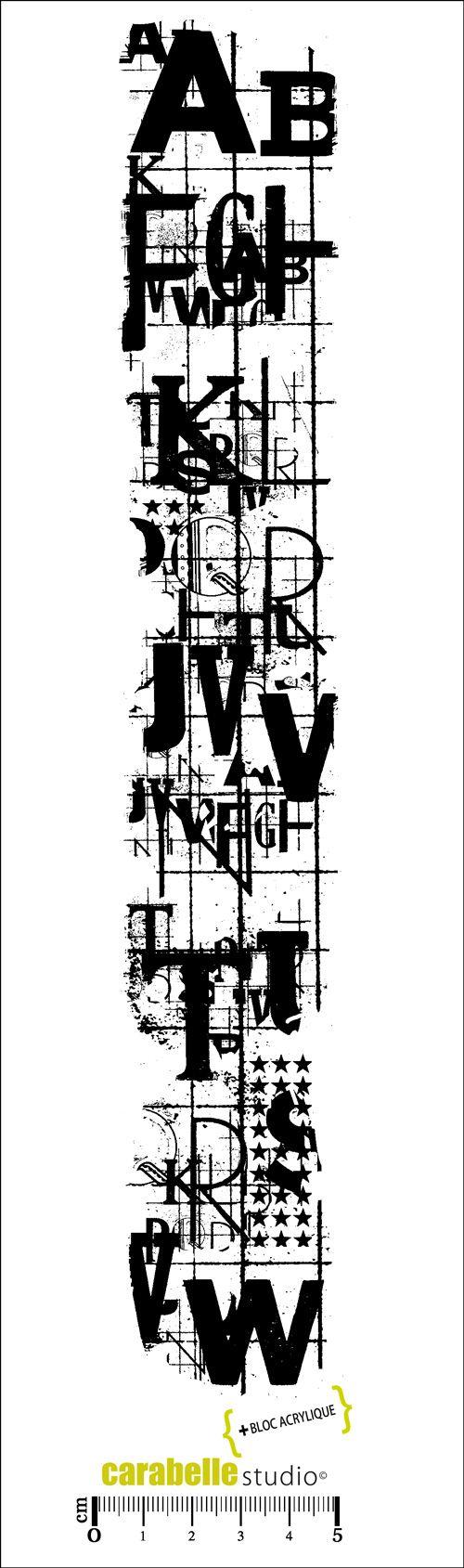 Tampon en Caoutchouc blanc monté sur mousse EZ MOUNT. Livré avec un bloc acrylique (6x31cm) Thème: Graphisme Dimension du tampon: 5x29cm.
