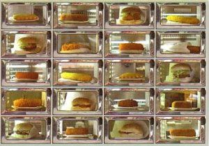Febo. Holland it the only country where they eat snacks from the wall, throw in two euros and pull out a delicious hamburger. Go around 1 in the morning after enough beers to the one at the Leidsestraat and be amazed by all the drunk people working there way through the little lockers