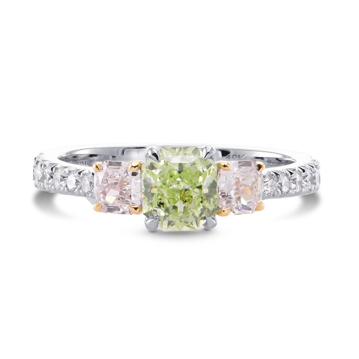 Of graceful color and brilliance...a Fancy Yellow Green radiant diamond, complimented with two very light pink cushion diamonds, mounted in a 3 stone ring setting, with collection colorless round brilliants along the shank. Mounted in platinum and rose gold. For more information about this item please contact our customer service department.