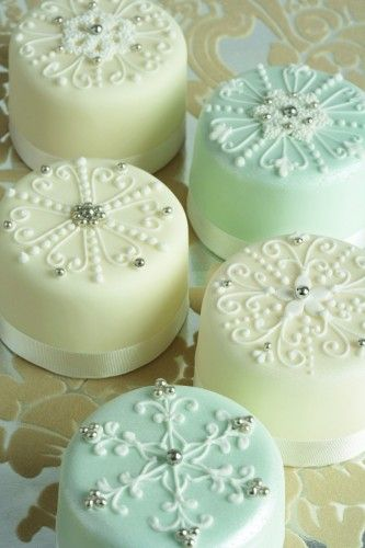 Christmas Cakes  Beautiful snowflakes.  The same designs would be pretty on cookies.